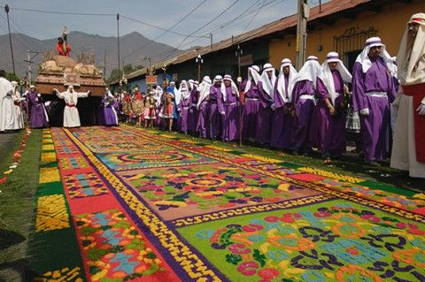 A carpet made from flowers and colored sawdust typical of Semana Santa (Holy Week) in Antigua, Guatemala (Photograph by Danita Delimont, Getty)