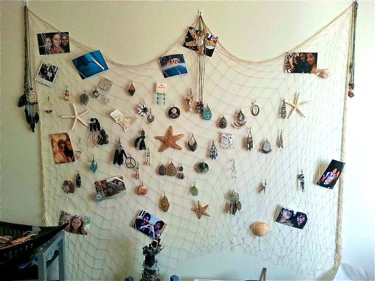 "hanged a fish net on ""command hooks"" for my ocean themed room. To hang my jewelry,, starfish & seashells,, & pictures of loved ones<3"