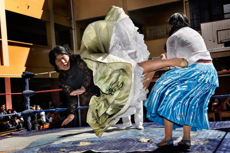 The Flying Cholitas, Bolivia: Lucha libre (Bolivian wrestling), is one of the most popular sports in the country. Women wrestlers are known as cholitas and have in the last ten years become popular in the sport. Carmen Rosa and Yulia la Pacena perform in a benefit show to raise money for the bathrooms of a school in La Paz, Bolivia, June 26, 2010. Second Prize Arts and Entertainment Stories, Daniele Tamagni, Italy.