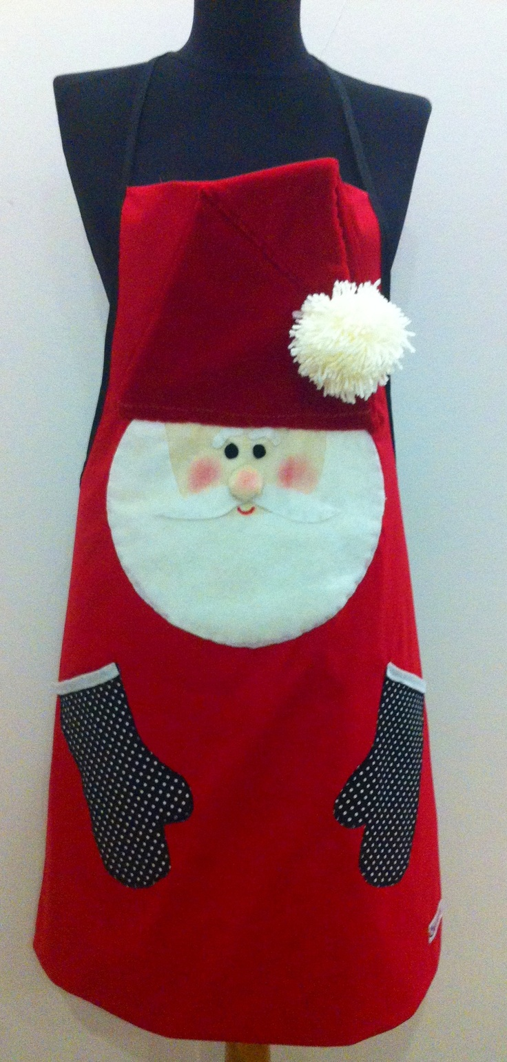 Get ready for some serious holiday baking with this fun, Santa Claus-embellished, hand-crafted apron.