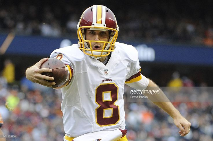 Kirk Cousins #8 of the Washington Redskins scores a touchdown during the first quarter against the Chicago Bears on December 13, 2015 at Soldier Field in Chicago, Illinois.