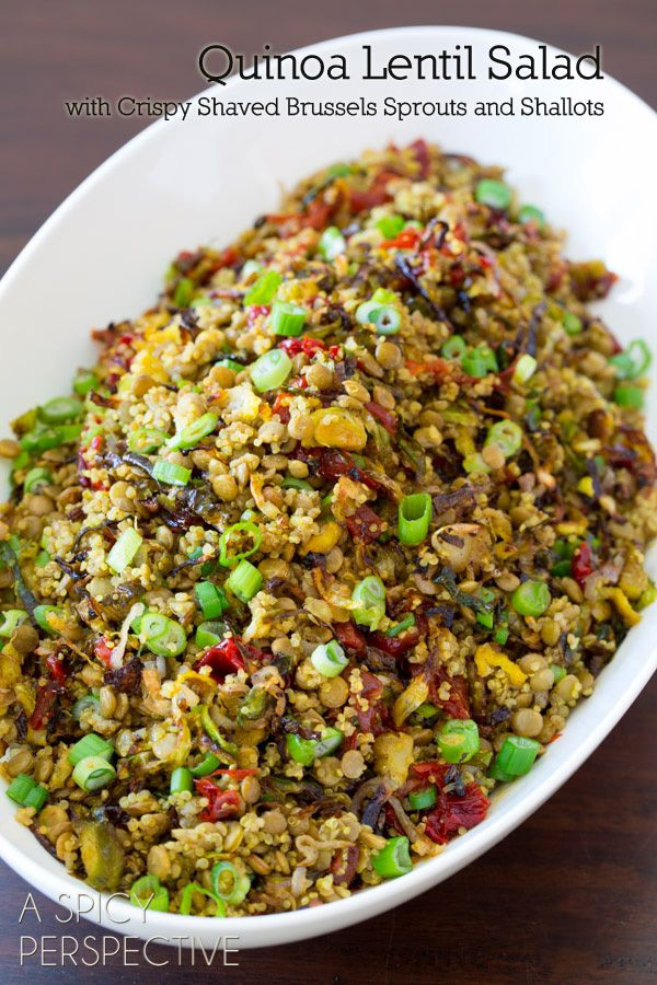 1 1/4 cup dried lentils, any color 2/3 cup dried quinoa 3 cups water 3/4 tsp. curry powder 8 oz. brussels sprouts 1 cup thinly sliced shallots (about 3-4) 2 Tb. olive oil 1/2 cup DeLallo Sun-Dried Peppers, chopped 1/2 cup chopped scallions 1/2 lemon, juiced Salt and peppe
