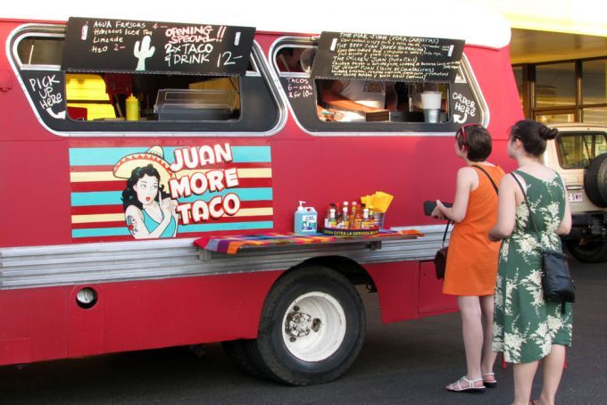 Juan More Taco's food truck in Brisbane street with people cueing up to be served