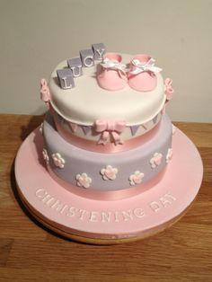 Girls christening cake pink and purple with booties www.cabdyscupcakes.co.uk