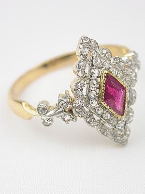 Rose cut diamonds create a triangle of light for a diamond shaped ruby in this classic Victorian ring. Circa 1900