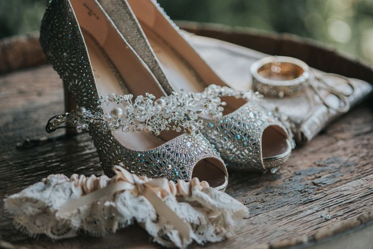 Gorgeous silver shoes, garter, and headpiece! (Feather & North Photography)