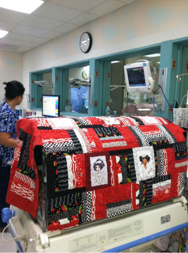 A NICU isolette cover with nurses in the squares