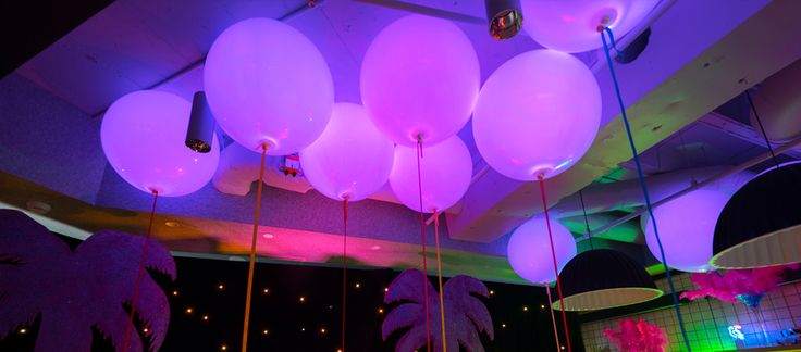 glowing balloons for a miami theme event