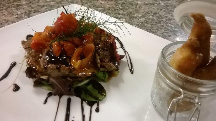 Straccetti di manzo con pomodorini e aceto balsamico. Thinly sliced beef with cherry tomatoes and balsamic vinegar