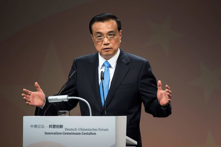 "The Chinese official warned the World Economic Forum in Dalian, China, against ""unilateral rules"" but didn't say how his country might lower its own trade barriers."