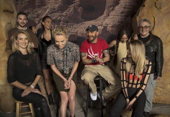 Tom Hardy with George Miller, Nicholas Hoult, Rosie Huntington-Whiteley, Courtney Eaton, Charlize Theron,  Zoe Kravitz and Abbey Lee pose during a press day for Mad Max: Fury Road. Los Angeles May 2nd 2015