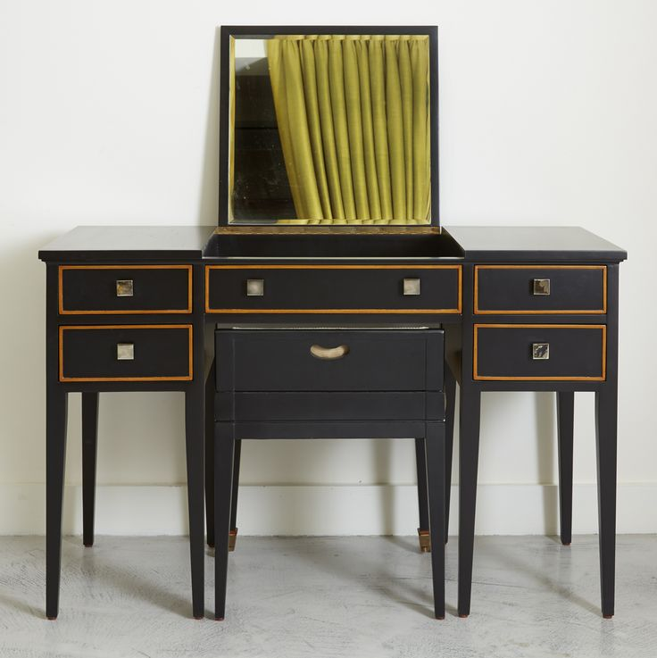 The Torberry dressing table features a mirror that flips down and a stool that fits neatly under the table simonhorn.com