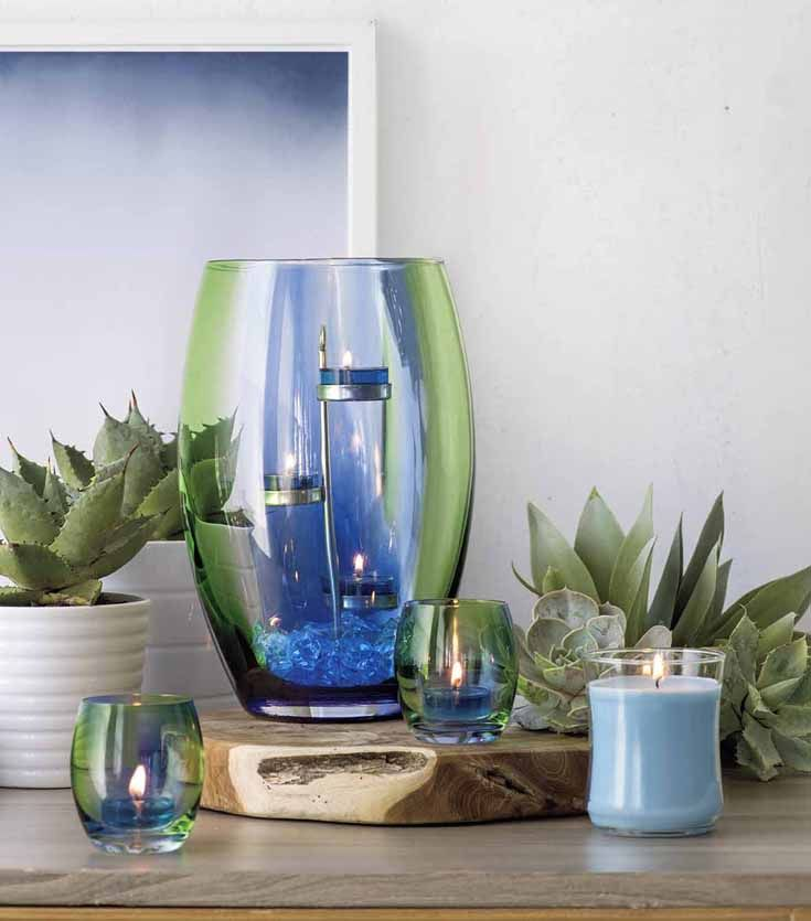 This artisan blown glass hurricane is awash in the vibrant shades of spring – the vivid green of fresh grass, the bright blue of the morning sky. Colour is applied by hand for a unique and beautiful work of art. Add a pillar or jar candle for a spectacular glow.