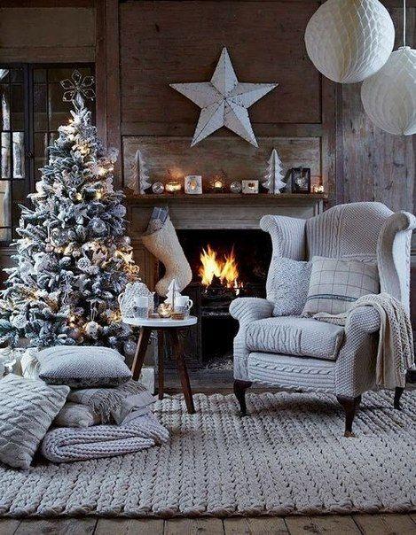 dat kleed is super maar ook die stoel met verschillende gebreide stukken..openhaard aan kerstboom en al die kussens erbij TOP