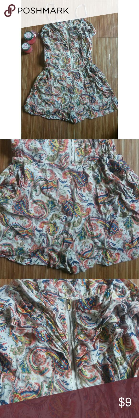 Romper with cute design A white romper with a kind of floral pattern made of multiple different colors. Only worn twice but is amazing for the summer! 60% cotton, 40% polyester. Also has pockets! Pants Jumpsuits & Rompers