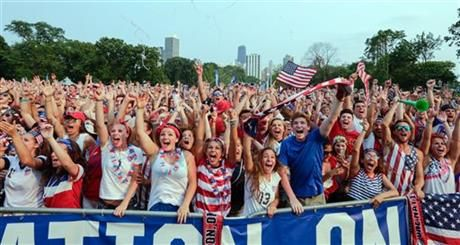 Fans of U.S. Soccer are seen cheering after a goal by Carli Lloyd during the Women's World Cup final Sunday, July 5, 2015. The fans watched the action on a jumbo screen at a watch party in Chicago's Lincoln Park. (AP Photo/Teresa Crawford) ▼6Jul2015AP|World Cup moments distanced women from FIFA scandal http://bigstory.ap.org/article/b57a51f9e0754ed6876a2fc1d63445cf #2015_FIFA_Womens_World_Cup #Final_United_States_vs_Japan