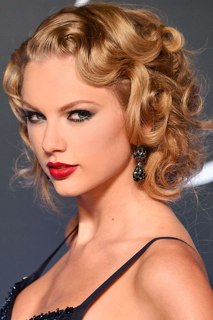 Swift's multi-shaped and size curls pin tucked underneath creates a polished retro style.   - HarpersBAZAAR.com
