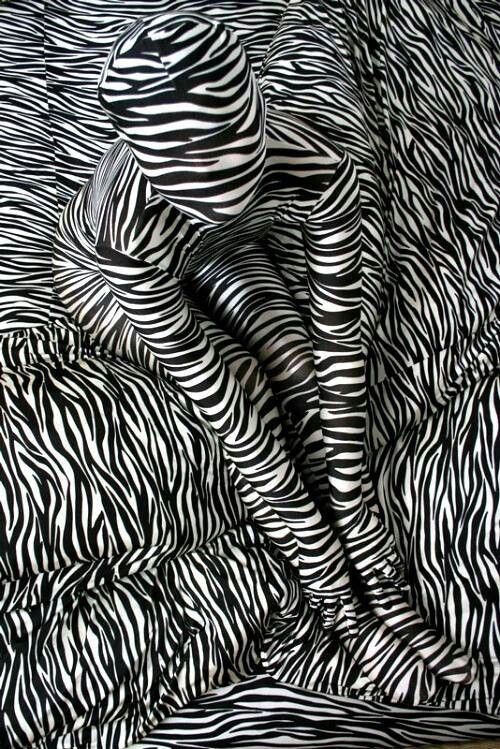 17. Three visual elements: -Movement: it appears that the person that is being portrayed is coming out of the background towards you. -Shape: The different lines create a shape of a human and give that illusion. -Pattern: the repetition of the stripes creates movement and also creates different wrinkles and illusions throughout the work.