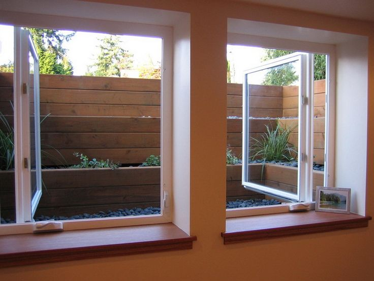 Egress Windows this is a great idea for basement windows. Note the raised beds outside the window. Great for added privacy.