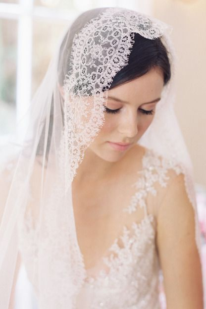 """The Duchese, an 80"""" circle drop blusher veil with a soft French Chantilly Lace edge."""
