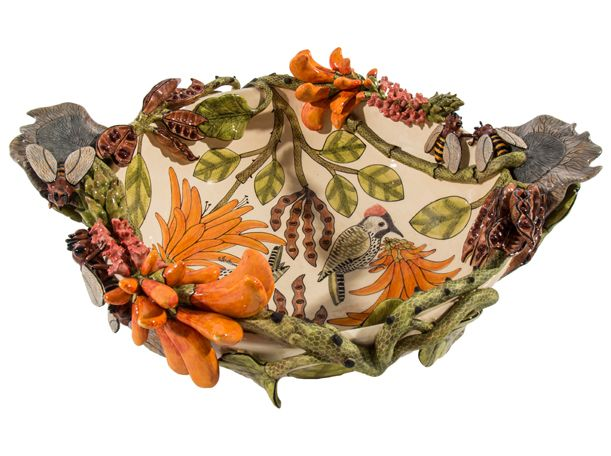 This exquisite Bee, Bearded Woodpecker and Coral Tree Bowl was made by Tebogo Ndlovu and painted by Jabu Nene. The coral tree or lucky bean tree plays a vital role in the ecosystem, providing food and shelter to insects, birds and animals. Woodpeckers are known to nest in the trunks of dead coral trees.