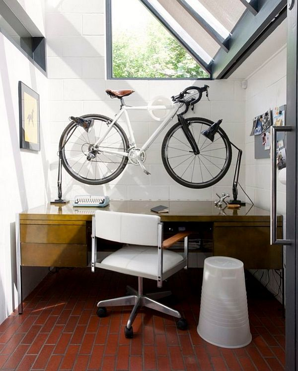 Compact home office with a wall-mounted bike above the desk!