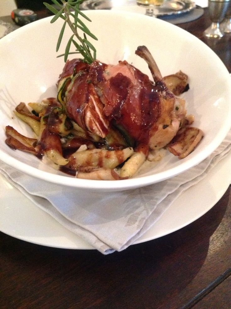 Parma Ham wrapped Chicken served on a bed of Almond and Bacon Potato Gnocchi and braised Zucchini topped with a  Porcini Mushroom Sauce