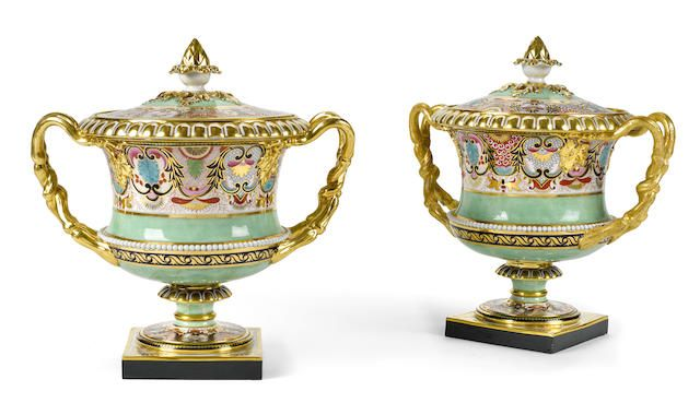 A pair of Barr Flight and Barr Worcester porcelain fruit coolers, liners and covers circa 1807-1813 Each surmounted by an artichoke finial, above an everted rim and waisted body with applied pearl ornament, flanked by entwined handles, on square plinth base