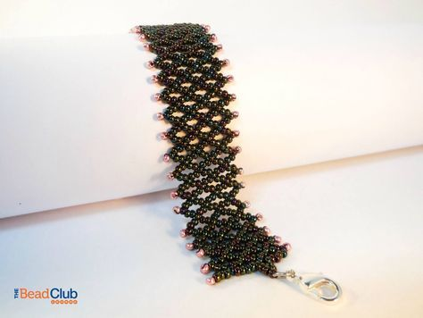 Learn how to make this simple but elegant Netted Bracelet using vertical netting stitch and two colours of seed beads. Click for the full tutorial. via @The Bead Club Lounge