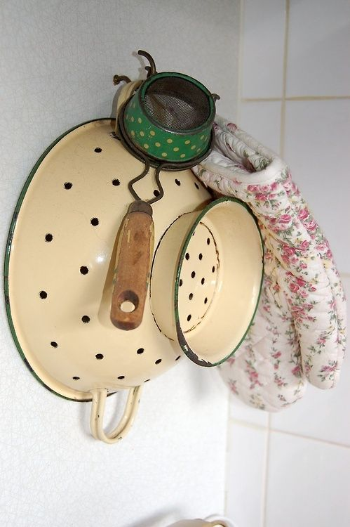 old colander and strainer with oven mitt