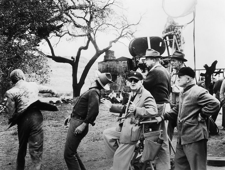 John Ford Director | John Ford stages a fight between James Stewart and John Wayne for The ...