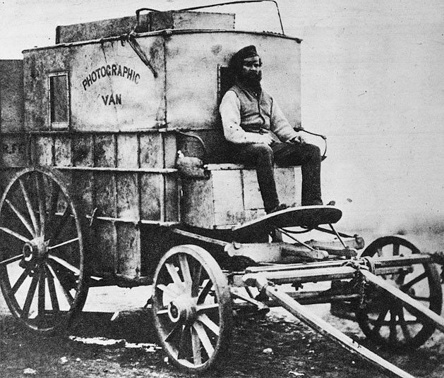 Roger Fenton's mobile darkroom where he developed glass plates within 10 minutes of their exposure. His assistant Marcus Sparling is seated on the cart - Crimean War 1853-56