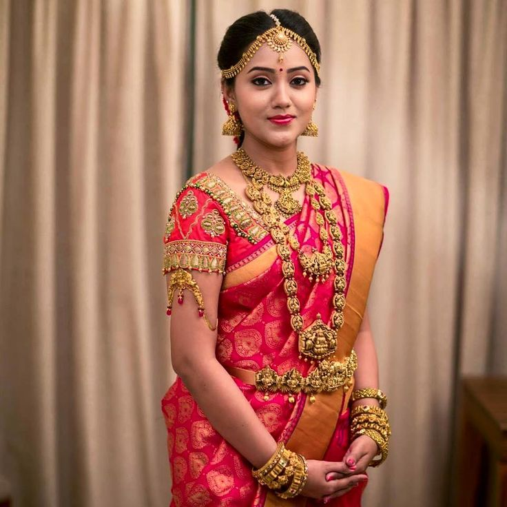 South Indian bride. Gold Indian bridal jewelry.Temple jewelry. Jhumkis. Red silk…