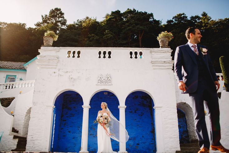 Bride and Groom having fun at Portmeirion UK at their wedding in Wales.