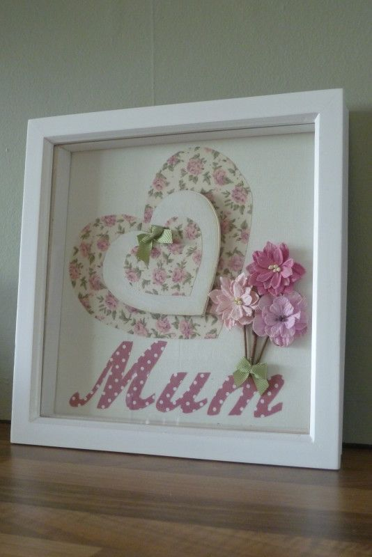 Framed heart, 'Mum' and flowers picture made using fabric and embellishments in shades of Pink and Cream in a 24 x 24cm glass fronted, deep boxed, White frame.
