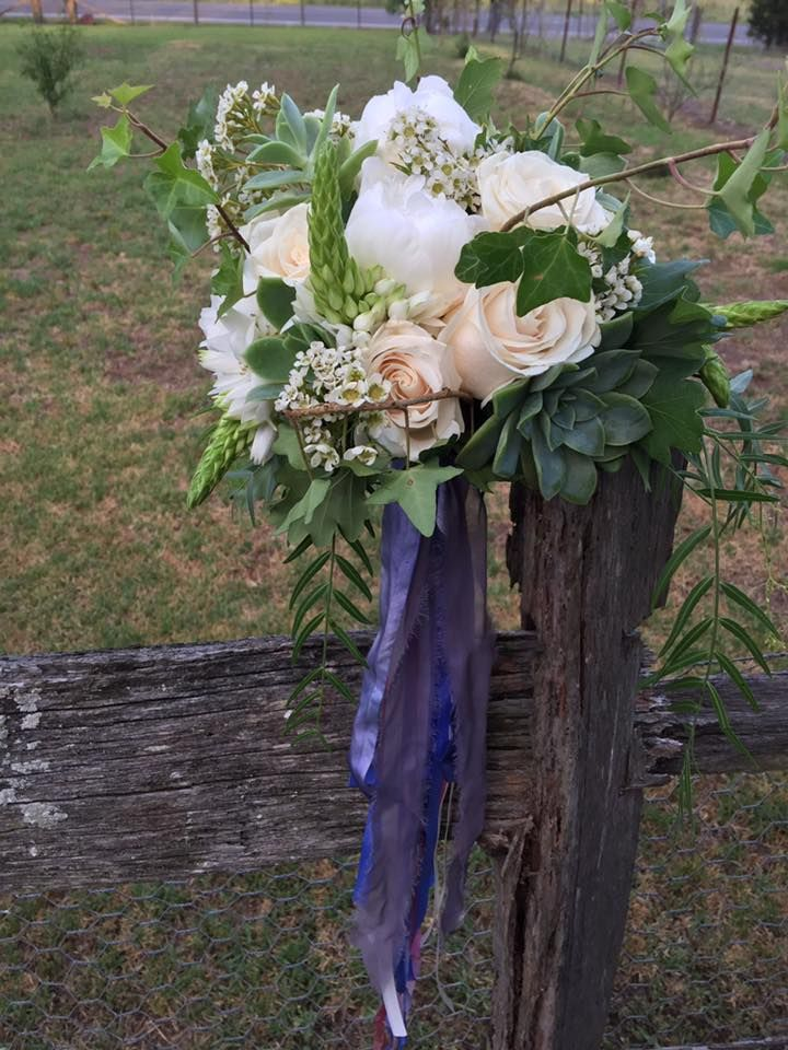 bridesmaid bouquet of peony, roses, succulents, chin and waxflowers created by lovely bridal blooms