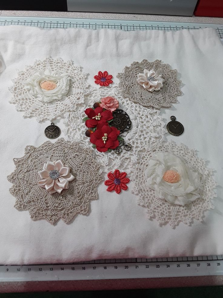 Canvas bag decorated with doilies and embellished