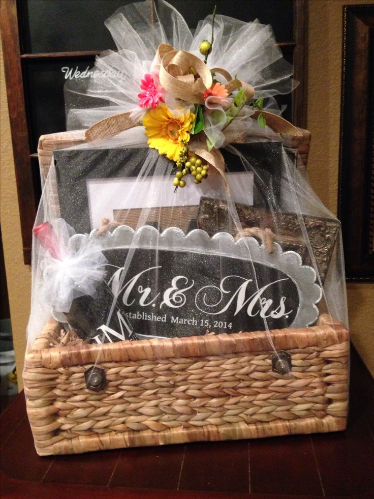 Wedding gift basket filed with personalized gifts made with my silhouette. Wrapped with tulle and burlap flower ribbon. I love a pretty present!