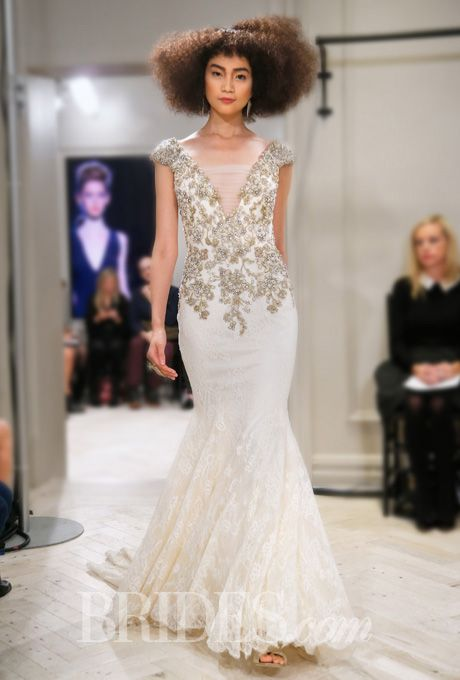 """Brides.com: Badgley Mischka Bride - Fall 2014. """"Ginger"""" gold and ivory lace mermaid wedding dress with illusion v-neckline and cap sleeves"""