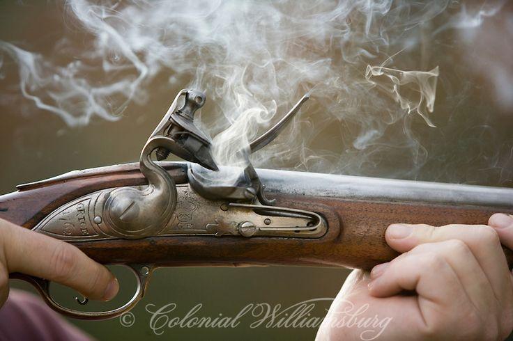 """Smoke curls around the lock of a freshly fired British """"Brown Bess"""" flintlock musket. @Melissa Squires Goodrich Williamsburg"""