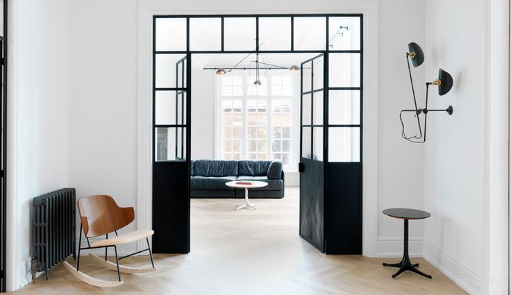 Minimalistic home in London with special doors.