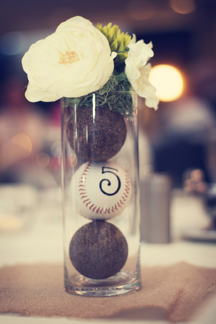 Adorable baseball-themed centerpieces! Photo by Angela. #minneapolisweddingphotographers #targetfield #baseballwedding