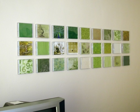 Use old CD jewel cases as wall art - just insert photos or scrapbooking paper. Awesome idea. AND you can change the image seasonally. :)