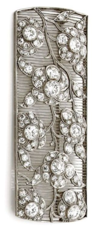 An Art Deco diamond and platinum brooch, circa 1930. The rectangular openwork brooch with floral motifs set with diamonds, mounted in platinum. #ArtDeco #brooch