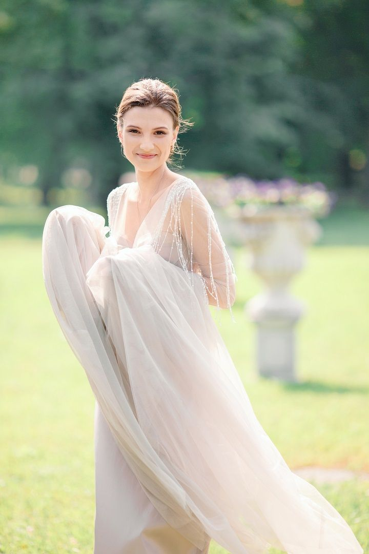 The beautiful bride wears off white wedding dress