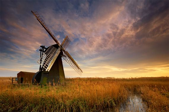 The windmill is to the right of the photo with a lot of blank space to the right
