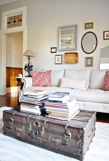 NTS: Assortment of framed mirrors behind couch.