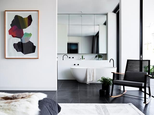 Luxury bathroom from a high-end Melbourne apartment designed by Hassell and styled by Simone Haag. Photo: Mark Roper
