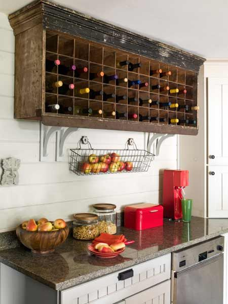 This antique postal box was hung up in the kitchen to store wine. | antique postal box to store wine | Photo: Helen Norman