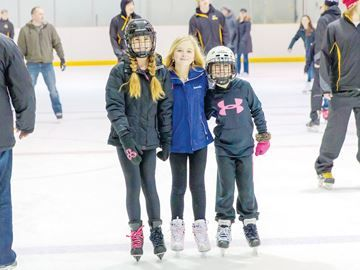 Free family skate Sunday in Alliston - Melissa Butterfield enjoys time with her friends Mackenzie and Reghan Butler at a family skate sponsored by Simcoe-Grey MP Kellie Leitch in Tottenham. Members of the Tottenham Steam hockey team also took to the ice to skate with fans at the event.